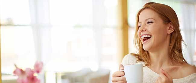 happy woman holding a mug