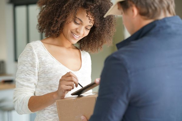 woman signing shipping form