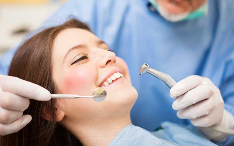 dental tools and girl smiling