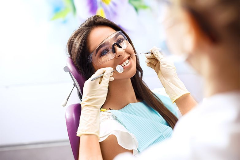 dentist and woman smiling