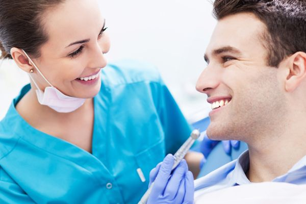 dentist and patient happy