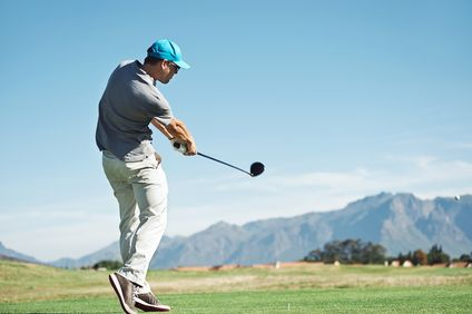 man striking ball with a golf club