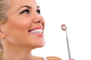 A woman enjoys the benefits of cosmetic crowns in her smile