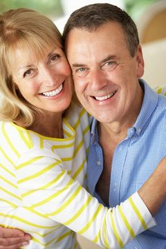couple smiling and showing their teeth at the camera