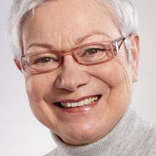 Headshot of senior female smiling into camera