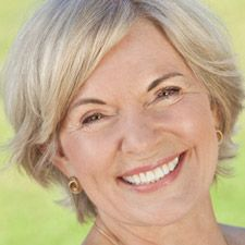 Headshot of a senior woman smiling into the camera